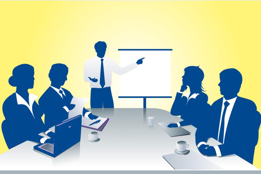 Personale di un'azienda in sala riunione